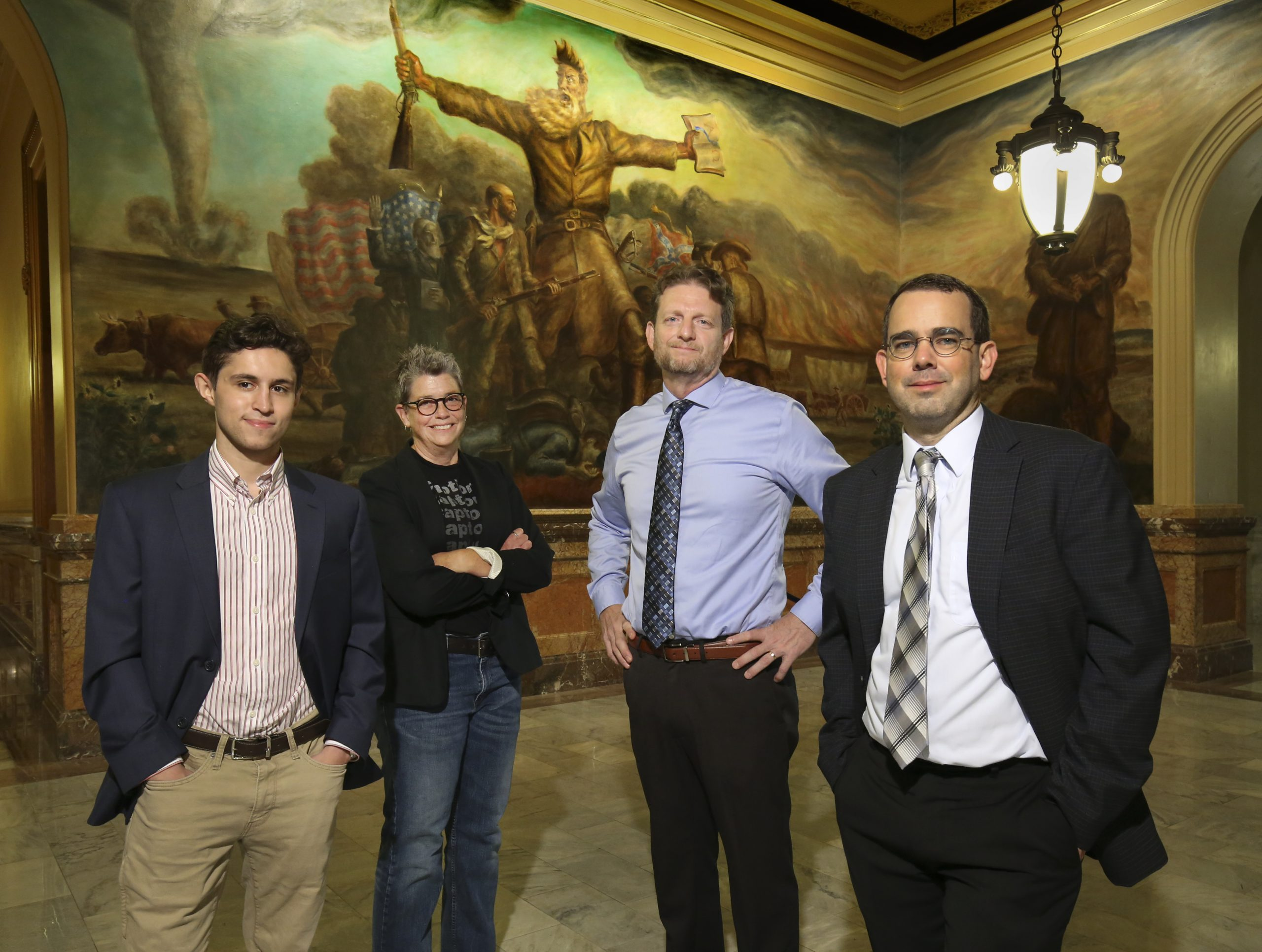 Kansas Reflector editor in chief Sherman Smith, right, is the Kansas Press Association's 2021 journalist of the year for work published in 2020. In the image he's joined by Kansas Reflector colleagues, from left, reporter Noah Taborda, opinion editor C.J. Janovy and senior reporter Tim Carpenter at the Capitol. (Thad Allton for Kansas Reflector)