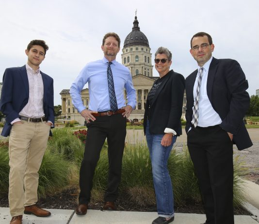 From left, Kansas Reflector's founding team members are reporter Noah Taborda, senior reporter Tim Carpenter, opinion editor C.J. Janovy and editor in chief Sherman Smith. (Thad Allton for Kansas Reflector)