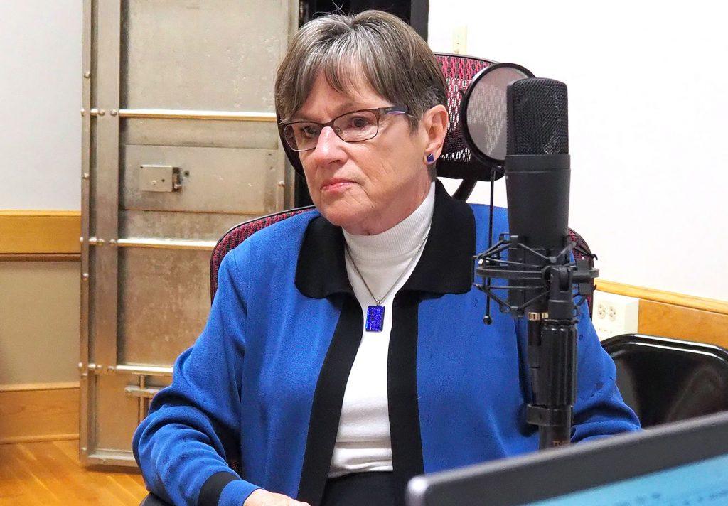 Gov. Laura Kelly prepares for a podcast recording at Kansas Reflector's office. (Sherman Smith/Kansas Reflector)