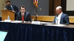 Attorney General Derek Schmidt, left, prefers the State Finance Council avoid discussing the details of lawsuit settlements in public to avoid compromising attorney-client privileges. (Tim Carpenter/Kansas Reflector)