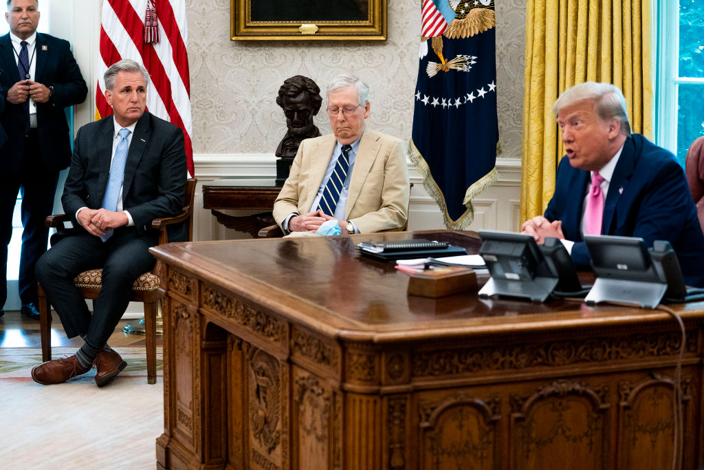 U.S. President Donald Trump talks to reporters Monday while hosting House Minority Leader Kevin McCarthy (R-CA) and Senate Majority Leader Mitch McConnell (R-KY) in the Oval Office. Trump talked with congressional leaders about a proposed new round of financial stimulus to help the economy during the ongoing global coronavirus pandemic. (Doug Mills/Getty Images)