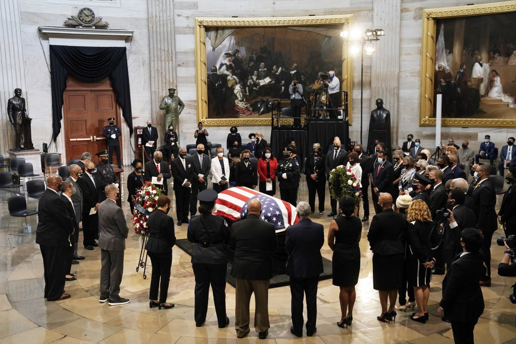 Members of the Congressional Black Caucus say farewell at the conclusion of Monday's memorial ceremony for the late U.S. Rep. John Lewis in the Capitol Rotunda. Lewis, a civil rights icon and fierce advocate of voting rights for African Americans, died July 17. (J. Scott Applewhite/Pool/Getty Images)