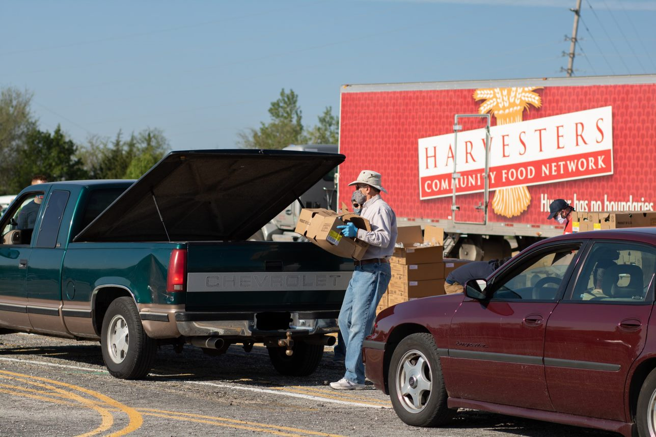 Harvesters, a private food bank, saw the amount of food distributed increase from 54 million pounds in 2019 to 65 million in 2020. In this picture, food is distributed at a drive-in in Kansas City, Kansas. (Harvesters — The Community Food Network)