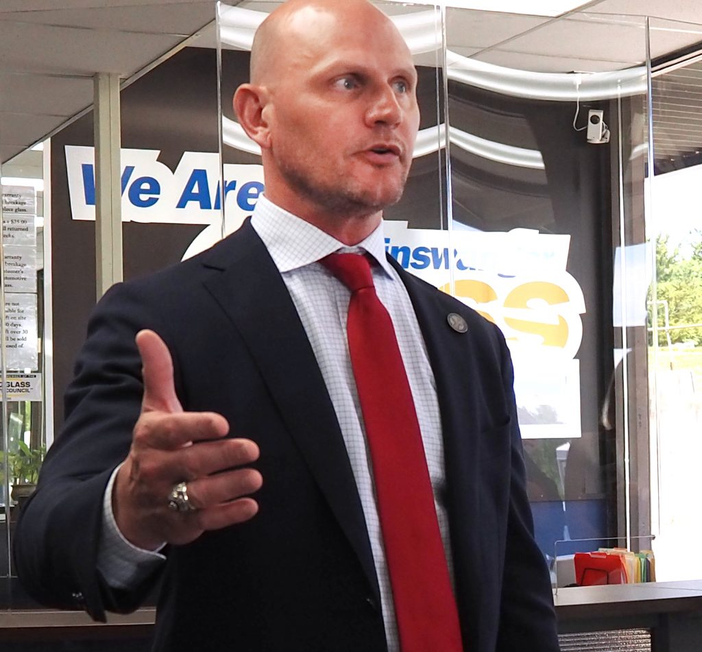 Secretary of State Scott Schwab, seen during a tour in June in Topeka of Binswanger Glass, which is making Plexiglas shields for polling sites, says voters in the August primary won't be denied a ballot based on whether they wear a mask. (Photo by Sherman Smith/Kansas Reflector)