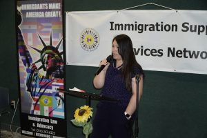 Yeni Telles, director of International Ministries USA for Saint Francis Ministries, speaks about her immigration story at World Refugee Day in June. (Submitted to Kansas Reflector)