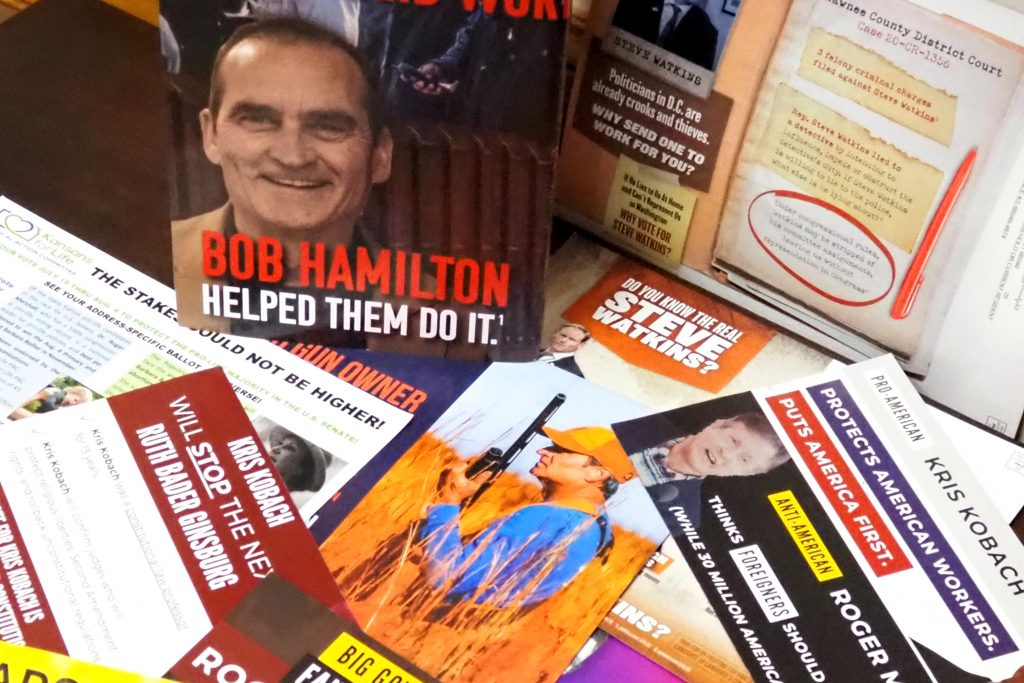 Kansas candidates for U.S. Senate and congressional seats during the primary ending Tuesday have produced a record number of TV commercials and flooded homes with direct-mail postcards that offer pointed commentary. (Sherman Smith/Kansas Reflector)