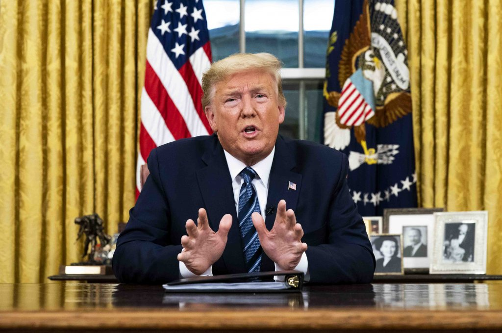 President Donald Trump addresses the nation in March from the Oval Office about the widening coronavirus crisis. He is expected to sign a bill that provides $9.5 billion over five years to pay down the National Park Service's maintenance backlog. (Doug Mills/Pool/Getty Images)