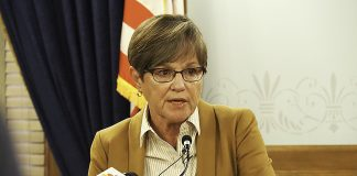 Gov. Laura Kelly and legislators on the State Finance Council agreed to reallocate $38 million in federal CARES Act money to urgent needs amid the COVID-19 surge and to earmark money unspent on Dec. 31 to the state's shrinking unemployment insurance fund. (Sherman Smith/Kansas Reflector)