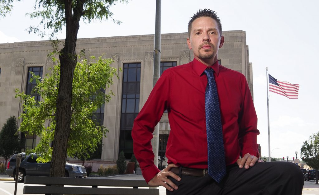 Former Emporia resident Brandon Flint, seen Wednesday in downtown Sioux City, Iowa, spent five years wrangling with the legal system in Kansas. With the help of Carl Folsom, the public defender maligned by Senate Republicans in June, the Army veteran testified before the Legislature and eventually cleared his name. (Jerry L. Mennenga for Kansas Reflector)