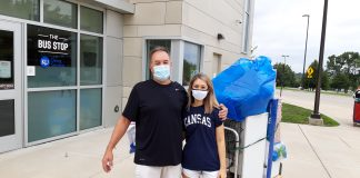 Brianna Ibarra, a Shawnee freshman at the University of Kansas, said Friday she willingly participated in the mandatory COVID-19 testing of students as the campus prepares for opening of fall semester classes. Her father, George, helped with her belongings outside a KU residence hall. (Tim Carpenter/Kansas Reflector)
