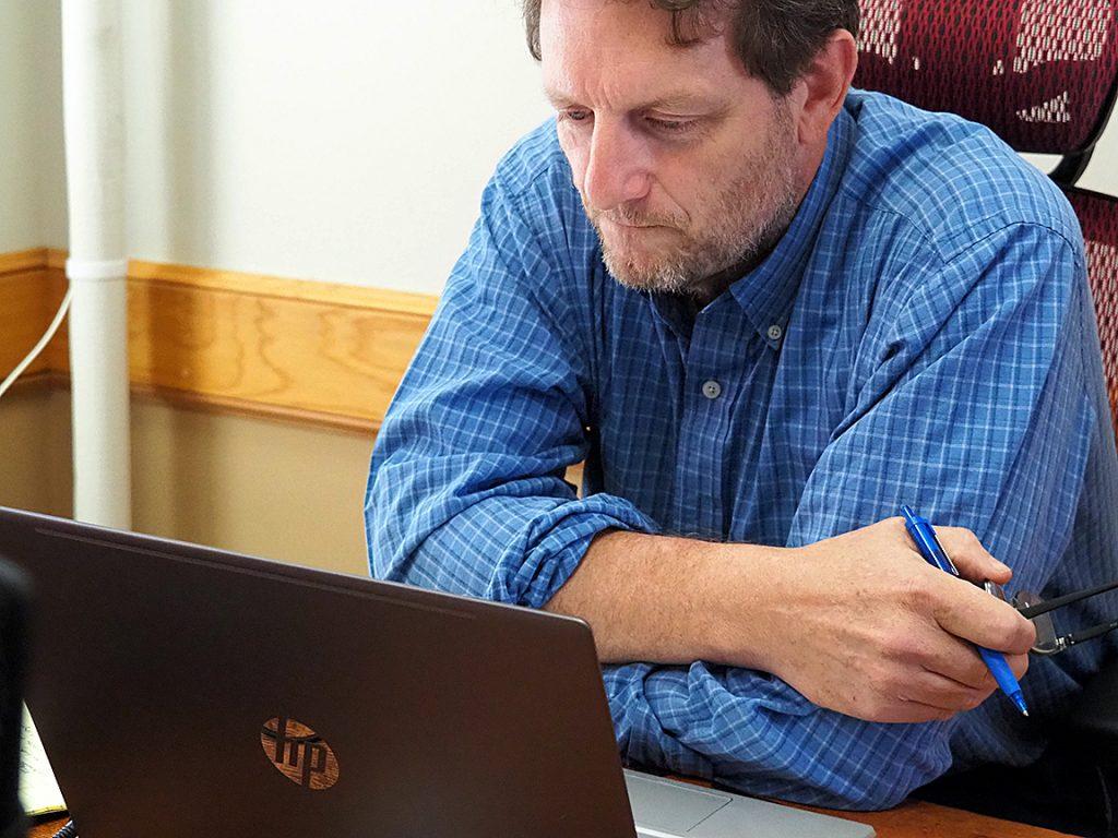 Senior reporter Tim Carpenter prepares to question political scientists during a recording of the Kansas Reflector podcast. (Sherman Smith/Kansas Reflector)