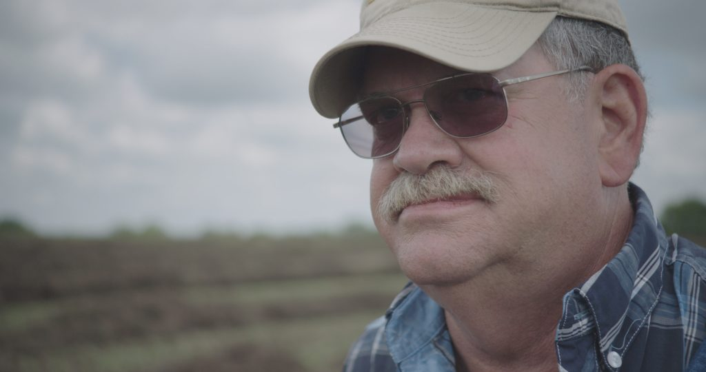 """Kansas farmer Donn Teske, who operates a family farm in Pottawatomie County, is featured in the documentary film """"The Disrupted"""" that blends the experiences of three hard-working Americans struggling to make it economically. (Submitted/Kansas Reflector)"""