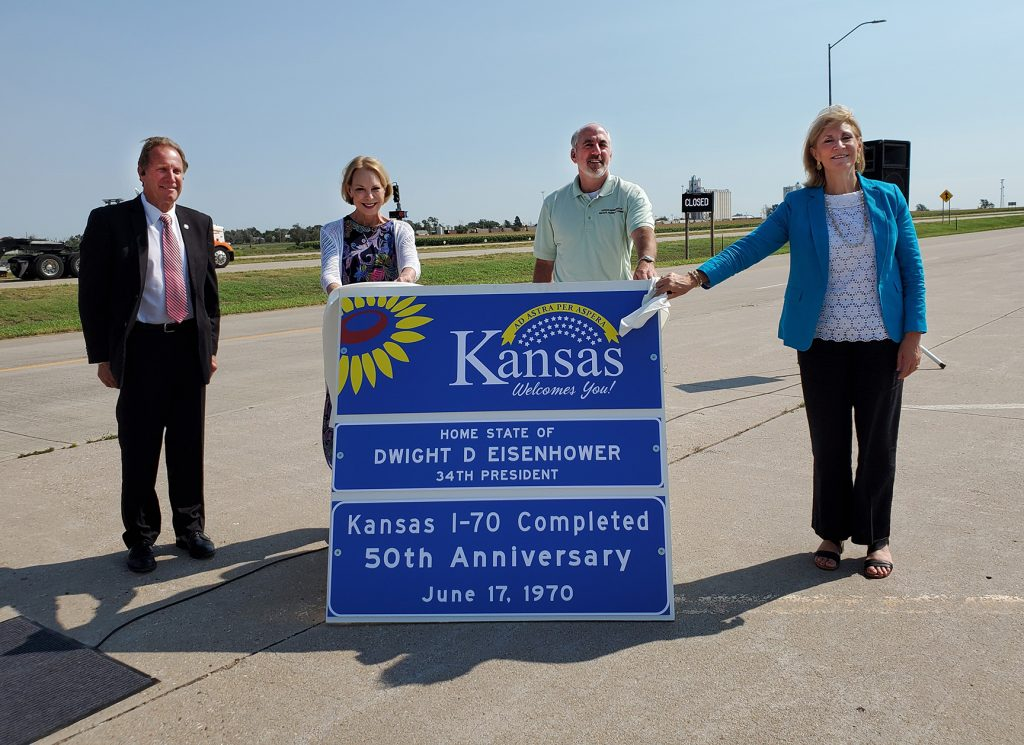 Reason Foundation estimates Kansas could net $1.1 billion over 50 years by leasing out the Kansas Turnpike, which runs from Oklahoma to Kansas City, Mo. In this image, Sen. Rick Billinger, Mary Eisenhower, and Kansas Cabinet secretaries Brad Loveless and Julie Lorenz participate in 50th anniversary celebration of Interstate 70, which isn't part of the turnpike. (Submitted/Kansas Reflector)