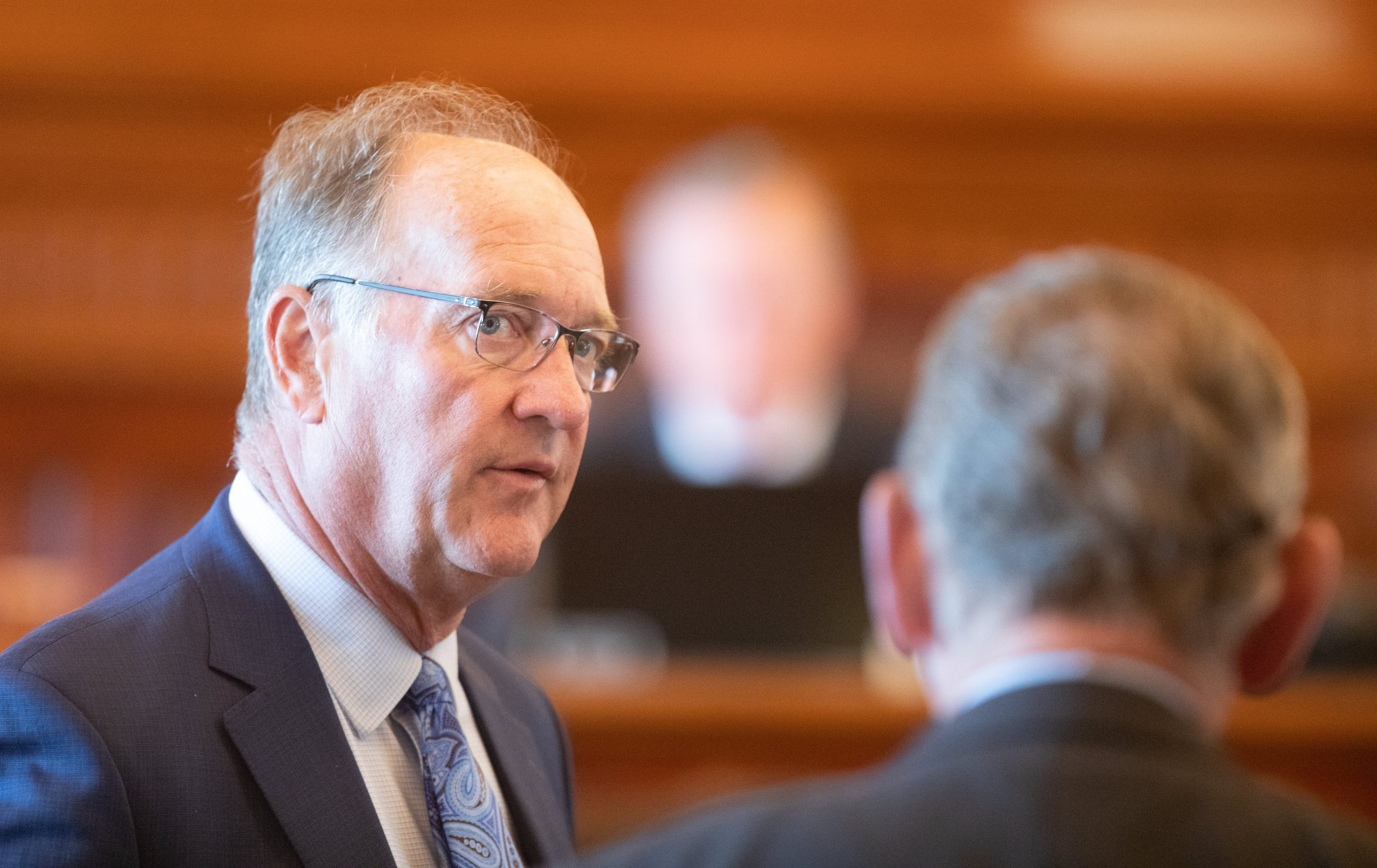 Senate Vice President Jeff Longbine, left, says differences of opinion about legalizing sports gambling in Kansas would have likely blocked completion of a bill in the 2020 session. Here the Emporia Republican chats during a special legislative session in June. (Nick Krug/Kansas Reflector)