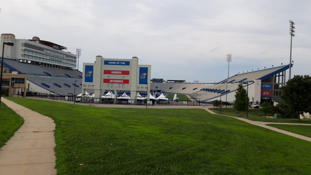 Bleachers at the University of Kansas' football stadium will remain empty for the Jayhawks' scheduled home game in September due to concern about spread of the COVID-19 virus. Kansas State University is moving ahead with plans to limit seating at home to 25% of capacity. (Tim Carpenter/Kansas Reflector)
