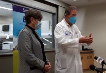 Gov. Laura Kelly and Jurgen Richt, a Kansas State University professor, on Thursday discuss COVID-19 research being conducted at the university's Biosecurity Research Institute in Manhattan. (Tim Carpenter/Kansas Reflector)