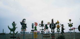 M.T. Liggett, a Mullinville folk artist, specialized in creating metal sculptures with biting commentary. The pieces lined his property along a Kansas highway and become something of a tourist attraction. (Submitted/Kansas Reflector)