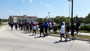 A long line of people marched at the University of Kansas to register frustration with pervasive racism and the indifference of some people to issues raised by the Black Lives Matter movement. (Tim Carpenter/Kansas Reflector)
