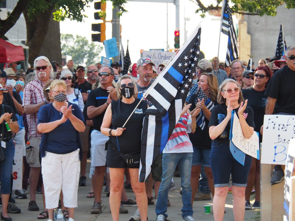 Hundreds of police supporters demonstrate for a Back the Blue rally Tuesday in downtown Topeka ahead of a special council meeting to discuss potential police reform. (Sherman Smith/Kansas Reflector)