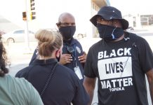 Law enforcement supporters and Black Lives Matter activists converged outside Topeka's city hall during August. Fort Hays State University's statewide survey shows 49% of Kansans believe Black Lives Matter sharpened the racial divide in the United States. (Sherman Smith/Kansas Reflector)