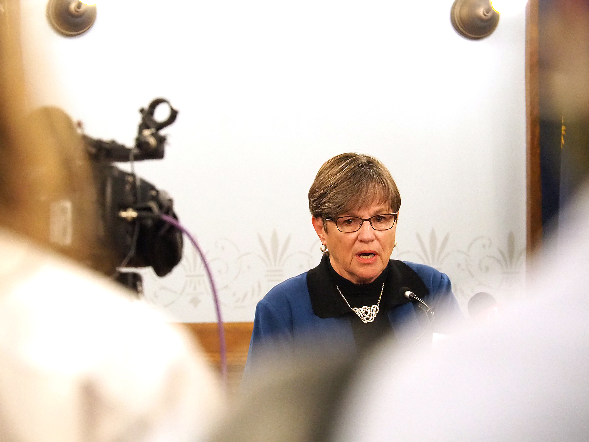 Gov. Laura Kelly said Monday during a news conference at the Capitol that counties can use federal COVID-19 aid to buy more drop boxes to handle anticipated flood of advance voting in the November election. (Sherman Smith/Kansas Reflector)