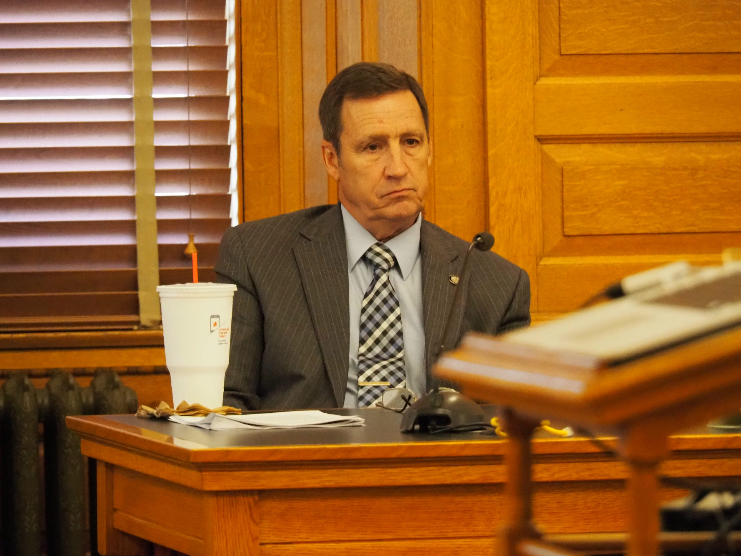 Sen. Dennis Pyle, a Hiawatha Republican, says he's disappointed state emergency management officials confirmed Tuesday the purchase of hospital gowns that turned out to be trash bags with arm holes cut in the corner. (Sherman Smith/Kansas Reflector)