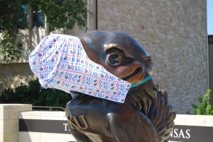 This masked Jayhawk statue sits outside the student union at the University of Kansas where Saturday an unscientific 30-minute survey of students and others walking outside indicated 71% were abiding by the campuswide mandate to wear a mask. (Tim Carpenter/Kansas Reflector)