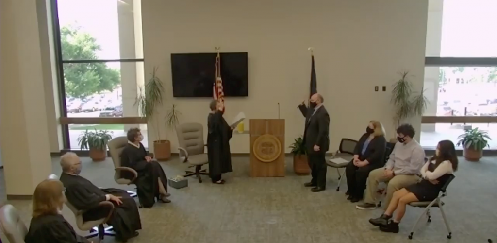 """Keynen """"KJ"""" Wall Jr. becomes the newest Kansas Supreme Court justice during a small, socially distanced swearing in ceremony Monday at the Kansas Judicial Center. (Screenshot from live stream)"""