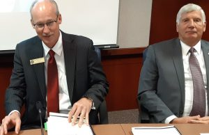Blake Flanders, left, president of the Kansas Board of Regents, says Kansas needs to invest tax dollars to build greater opportunities statewide for high school students to earn early college credit. At right is Bill Feuerborn, chairman of the state Board of Regents. (Submitted/Kansas Reflector)