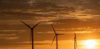 Gov. Laura Kelly said construction of Inevergy's new Grain Belt Express transmission line to carry wind-driven electricity to Missouri, Illinois and Indiana can create about 1,000 permanent jobs in Kansas. This image is of Evergy's Flat Ridge Wind Farm near Medicine Lodge. (Submitted/Kansas Reflector)