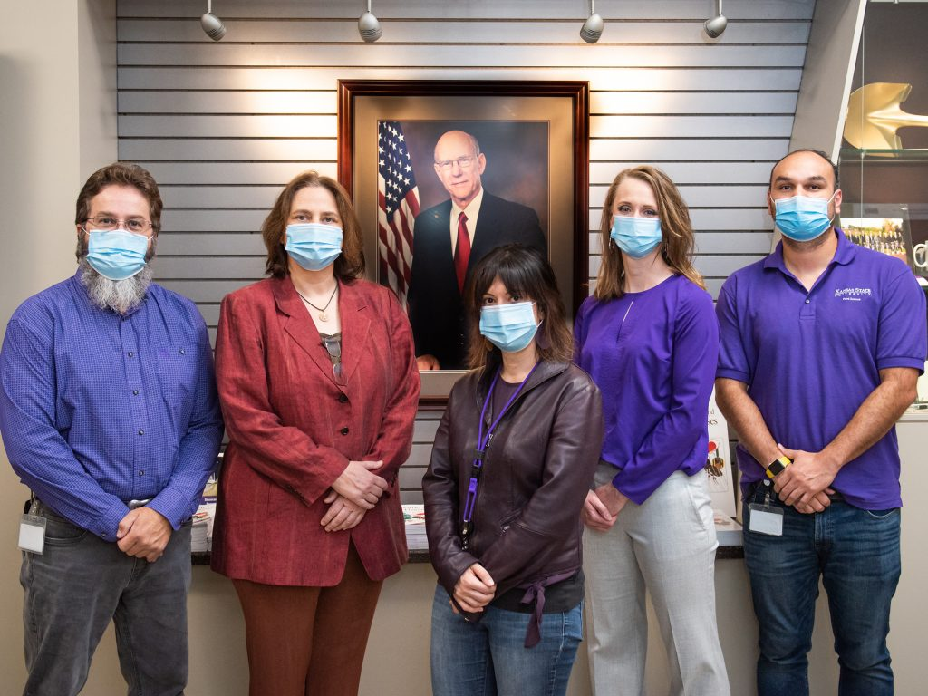Kansas State University researchers involved in a $1.3 million research project to protect meat plant workers and surrounding communities from the spread of COVID-19 includes, from left, Randy Phebus, Sally Davis, Valentina Trinetta, Sara Gragg and Daniel Vega. (Submitted/Kansas Reflector)
