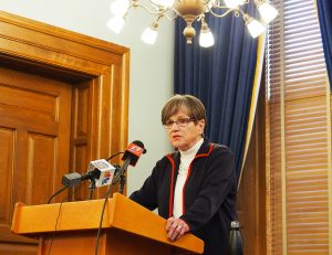 Gov. Laura Kelly said expansion of COVID-19 across Kansas necessitated issuance of a revised statewide executive order imposing a mask mandate, but leaving the option for counties to accept her version, draft their own or block any version of the mandate. (Sherman Smith/Kansas Reflector)