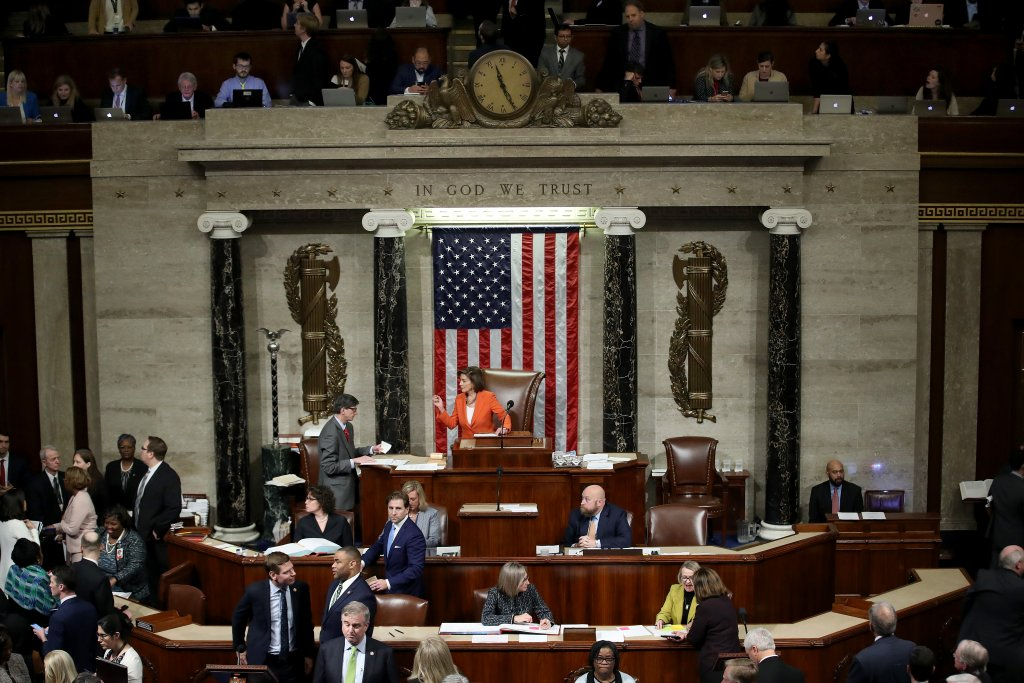 Under new rules adopted in May, representatives can designate a proxy rather than vote in person from the floor of the U.S. House, seen here in a file photo from October 2019. (Win McNamee/Getty Images)