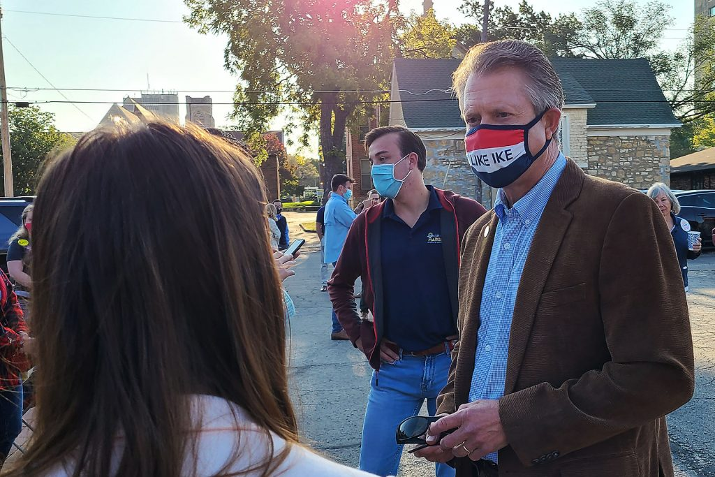 Republican U.S. Senate candidate Roger Marshall greets supporters during a campaign stop Tuesday in Topeka. His visit coincided with renewal of questions about abortion in the campaign pitting Marshall against Democratic nominee Barbara Bollier. (Sherman Smith/Kansas Reflector)