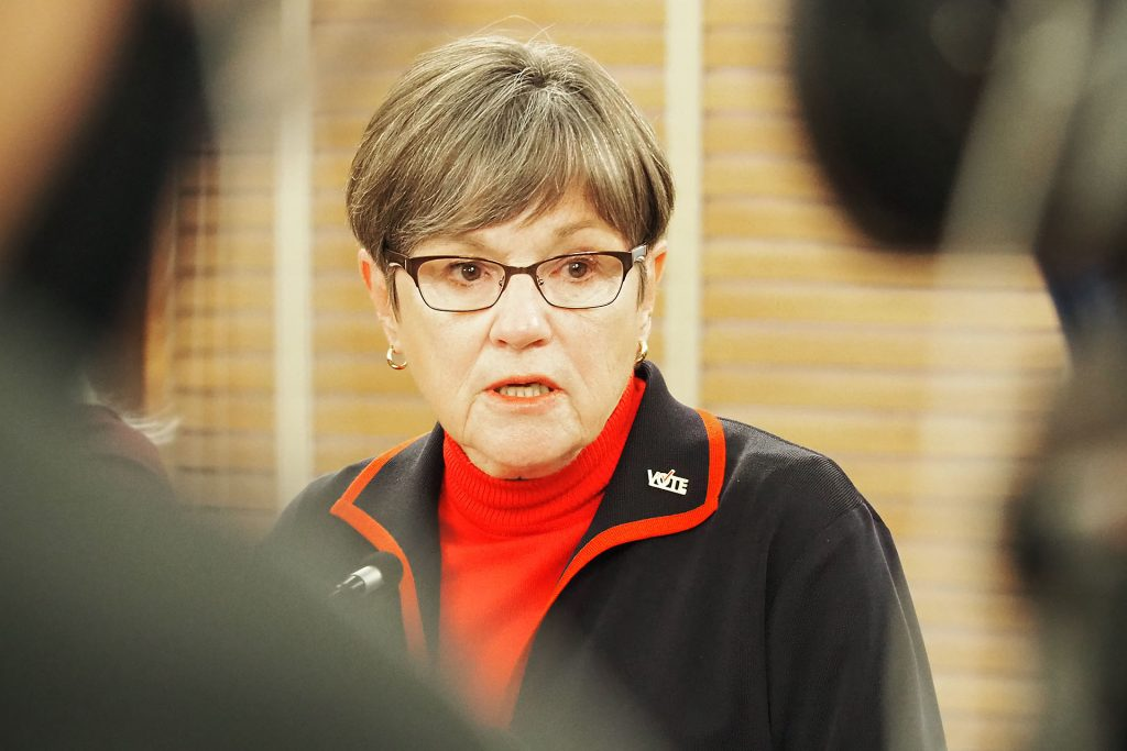 Gov. Laura Kelly, who expanded her statewide mask mandate as COVID-19 flourished, will brief reporters Wednesday after KDHE reported fatalities in the state surged 119 since Monday. (Sherman Smith/Kansas Reflector)