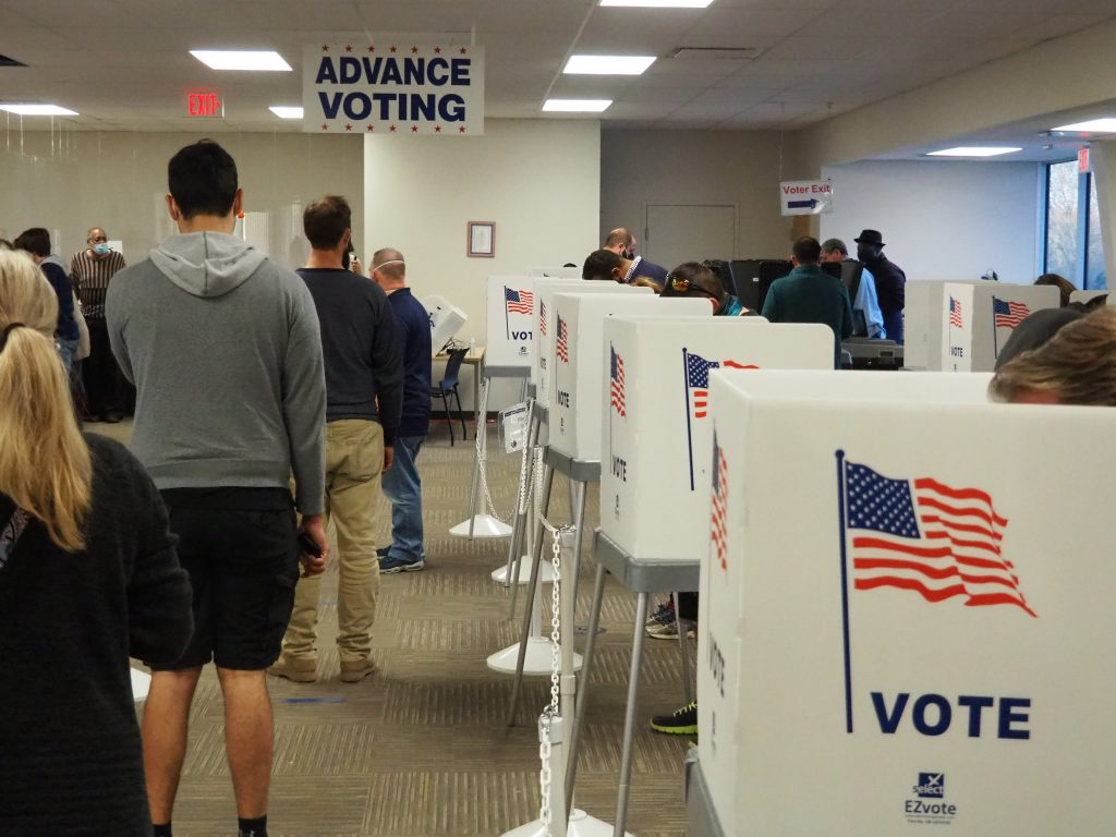 The administration of Gov. Laura Kelly reached agreement with a coalition of advocacy groups to bring state agencies into compliance with federal law requiring people on public assistance receive voter registration information. (Noah Taborda/Kansas Reflector)