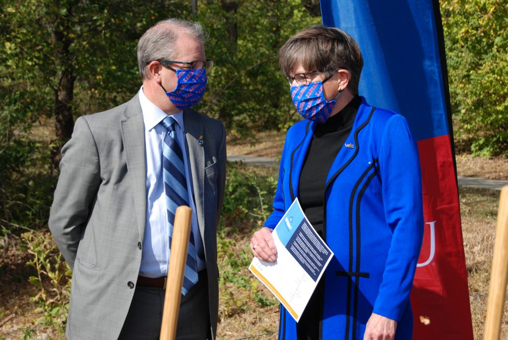 University of Kansas chancellor Doug Girod and Gov. Laura Kelly chat during a groundbreaking ceremony on campus in Lawrence. The KU Faculty Senate discussed but didn't formally vote on a motion of no confidence in the chancellor and provost Barbara Bichelmeyer. (Tim Carpenter/Kansas Reflector)