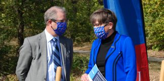 University of Kansas chancellor Doug Girod and Gov. Laura Kelly chat during a recent groundbreaking ceremony at the University of Kansas in Lawrence. (Tim Carpenter/Kansas Reflector)