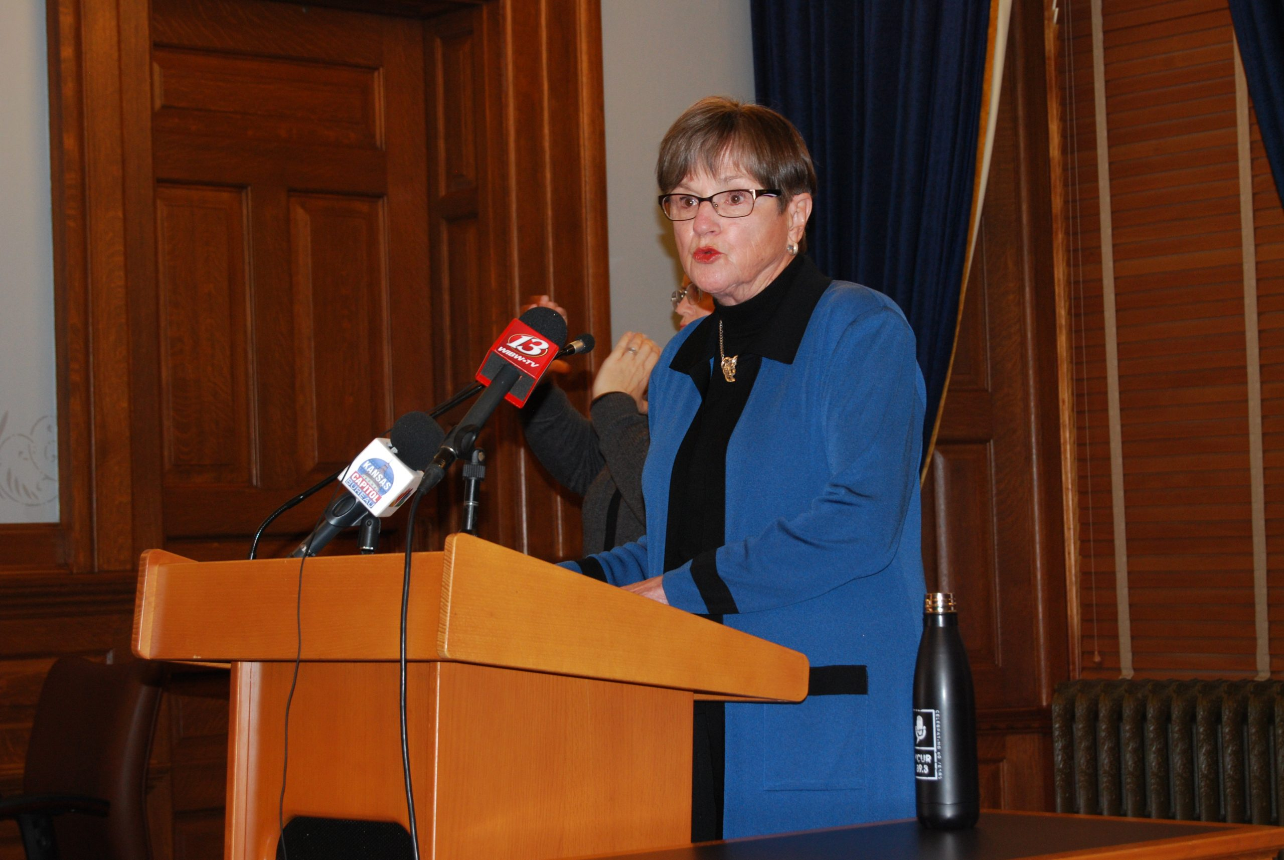 Gov. Laura Kelly is responding to the 2,400 average daily increase in new COVID-19 cases in Kansas with a public-service campaign to educate people about avoiding the virus and a $45 million surge in spending on a broader testing initiative. (Tim Carpenter/Kansas Reflector)