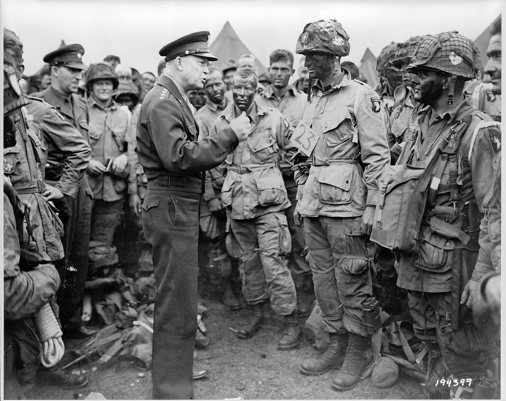 Gen. Dwight Eisenhower speaks with American paratroopers in England on the evening of June 5, 1944, as they prepare for the Battle of Normandy. Presidential historians assembled by C-SPAN rated Eisenhower 5th in terms of presidential leadership. President Harry Truman ranked 6th. (Library of Congress)