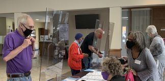 Four Kansas organizations filed a lawsuit Tuesday challenging constitutionality of two sweeping election reform bills placed into law by the 2021 Legislature after deflecting vetoes by Gov. Laura Kelly. Here, voters cast ballots at United Methodist Church in Topeka. (Noah Taborda/Kansas Reflector)