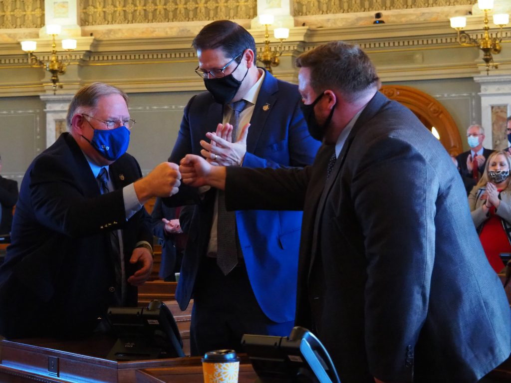 House Majority Leader Dan Hawkins, House Speaker Ron Ryckman and House Speaker Pro Tem Blaine Finch, left to right, return to Topeka on Monday to grapple with Gov. Laura Kelly's vetoes and a series of unfinished bills. (Noah Taborda/Kansas Reflector)