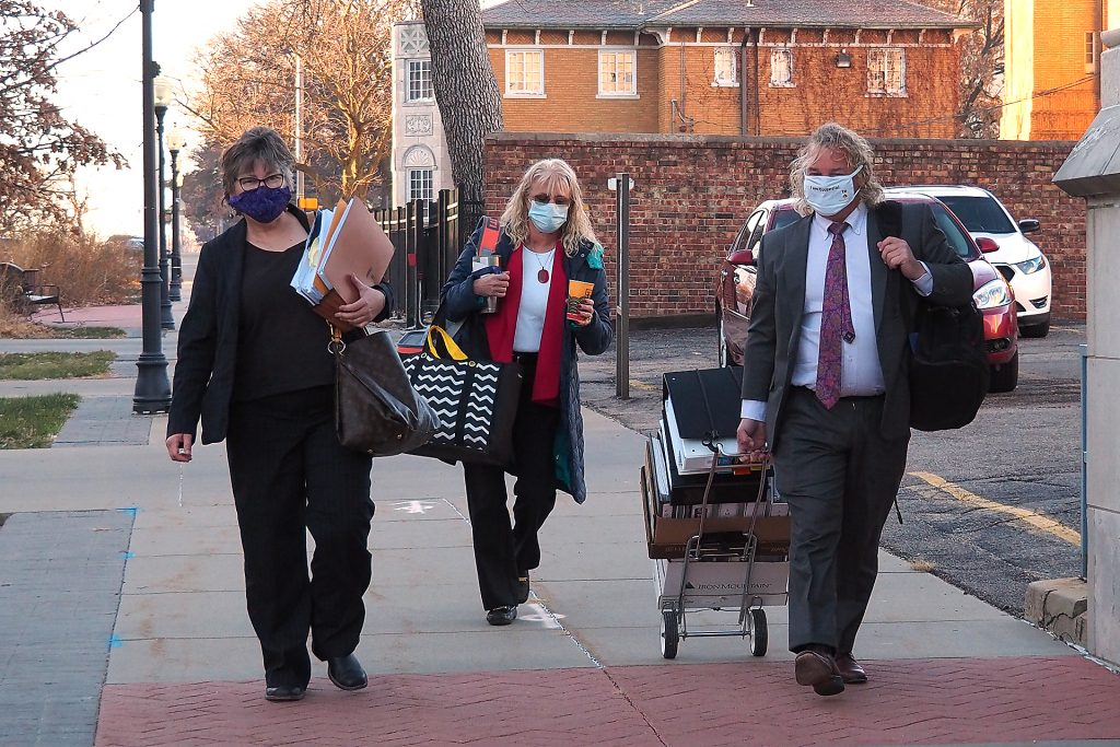 Jacqie Spradling, left, arrives with her legal team for a 2020 disciplinary hearing into alleged misconduct by Spradling as a prosecutor in Shawnee and Jackson counties. The panel recommended disbarment of Spradling and she has since resigned from jobs in Allen and Bourbon counties. (Sherman Smith/Kansas Reflector)