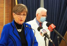 Gov. Laura Kelly said initial COVID-19 vaccine shipments will be dedicated to medical personnel working with high-risk coronavirus patients and the vulnerable residents of nursing homes before turning to Phase 2 recipients above the age of 65 and people in lowe-risk health care jobs. (Noah Taborda/Kansas Reflector)