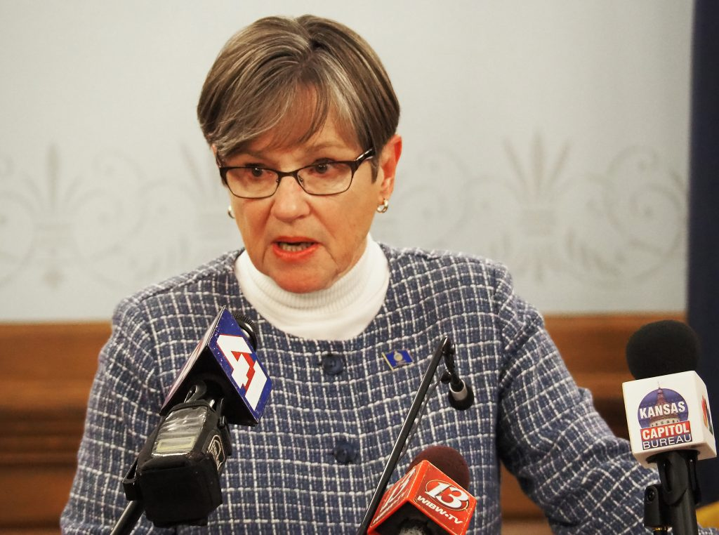 Democratic Gov. Laura Kelly said Friday that she signed a bill unanimously passed by the Legislature to require greater scrutiny by state and law enforcement officials of alleged child abuse. (Sherman Smith/Kansas Reflector)