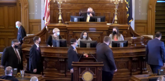 Republican state Rep. Ken Rahjes, walking at far left in this image, tested positive for COVID-19 after attending meetings Monday at the Capitol to select House and Senate leaders for the 2021 session. House GOP officials issues a letter warning lawmakers of possible exposure to the coronavirus. (Screenshot by Kansas Reflector)