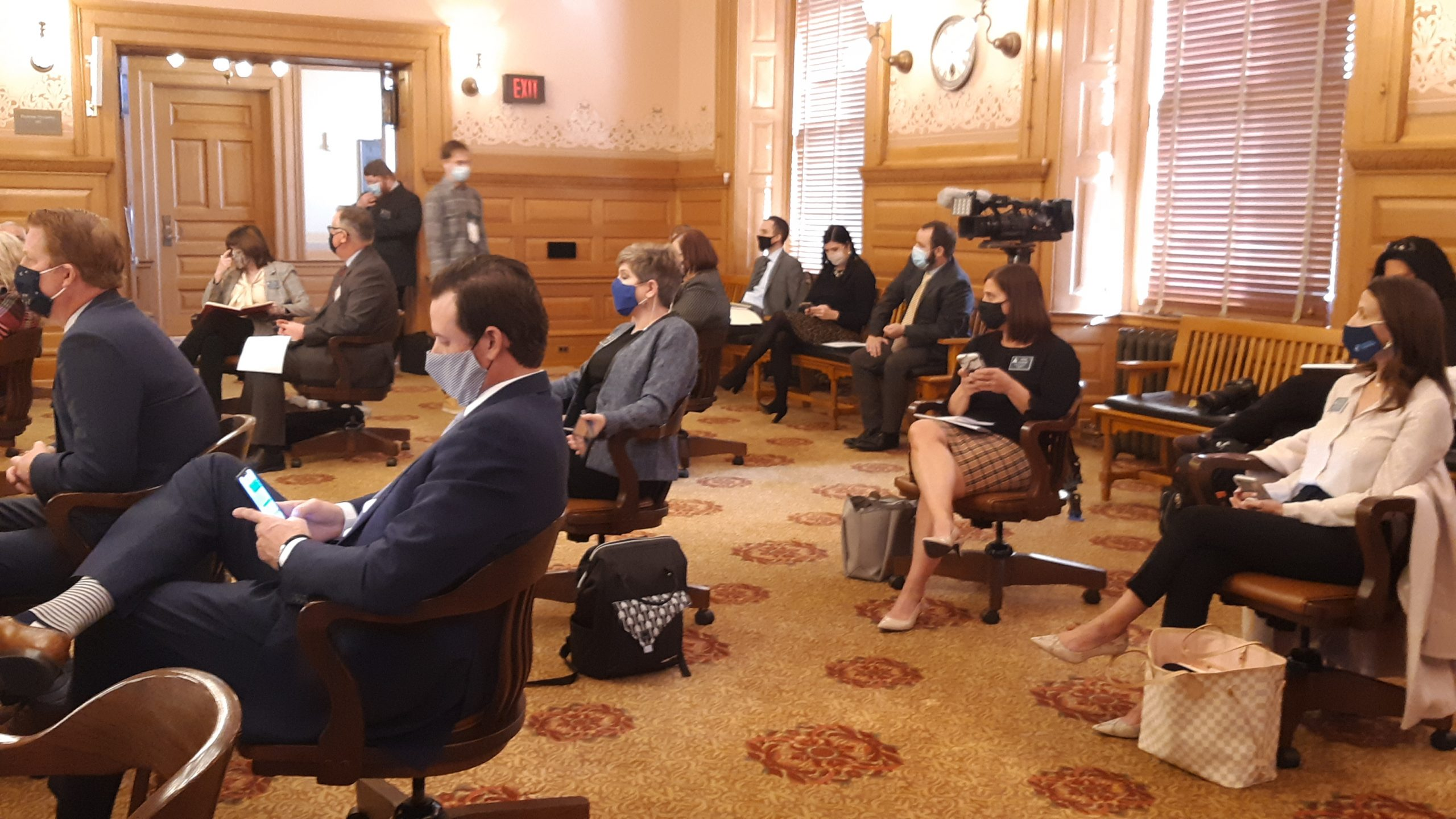 Lobbyists socially distance during a Senate Judicary Committee hearing Tuesday on extension until March 31 of a law detailing state and local government authority for responding to the COVID-19 pandemic. The House is working on a comparable bill. (Tim Carpenter/Kansas Reflector)
