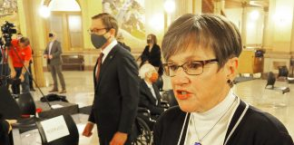 Gov. Laura Kelly signed Senate Bill 15 during a bipartisan news conference Thursday in the Capitol to create a maximum $60 million loan program for businesses with less than 200 employees struggling during the COVID-19 pandemic. (Sherman Smith/Kansas Reflector)