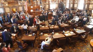 Following the swearing-in ceremony for members of the Kansas Senate on Monday the families of lawmakers flooded the chamber for photographs. There is no mask mandate in the Senate chamber, and many in the throng chose not to wear one despite the COVID-19 pandemic. (Tim Carpenter/Kansas Reflector)