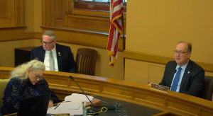 Sen. Jeff Longbine, right, chairman of the Senate Financial Institutions and Insurance Committee, moved quickly to conduct a hearing for Senate Bill 245, which would offer the investor-owned Evergy the option of issuing bonds to finance retirement of old coal plants. Evergy customers would be obligated to pay off the bonds through monthly fees. (Screen capture/Kansas Reflector)